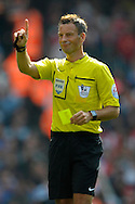 Referee Mark Clattenburg shows a yellow card.  Barclays Premier league match, Arsenal v Manchester city at the Emirates Stadium in London on Saturday 13th Sept 2014.<br /> pic by John Patrick Fletcher, Andrew Orchard sports photography.
