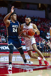 NORMAL, IL - November 29: Lijah Donnelly drives in on Kaj Days during a college basketball game between the ISU Redbirds and the Prairie Stars of University of Illinois Springfield (UIS) on November 29 2019 at Redbird Arena in Normal, IL. (Photo by Alan Look)
