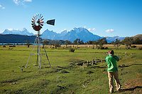 Photographer Working the Windmill at Lazo Estancia in Patagonia. Paine National Park, Lago Verde, Chile. Image taken with a Nikon D3x and 16-35 mm f/4 lens (ISO 100, 35 mm, f/11, 1/80 sec).