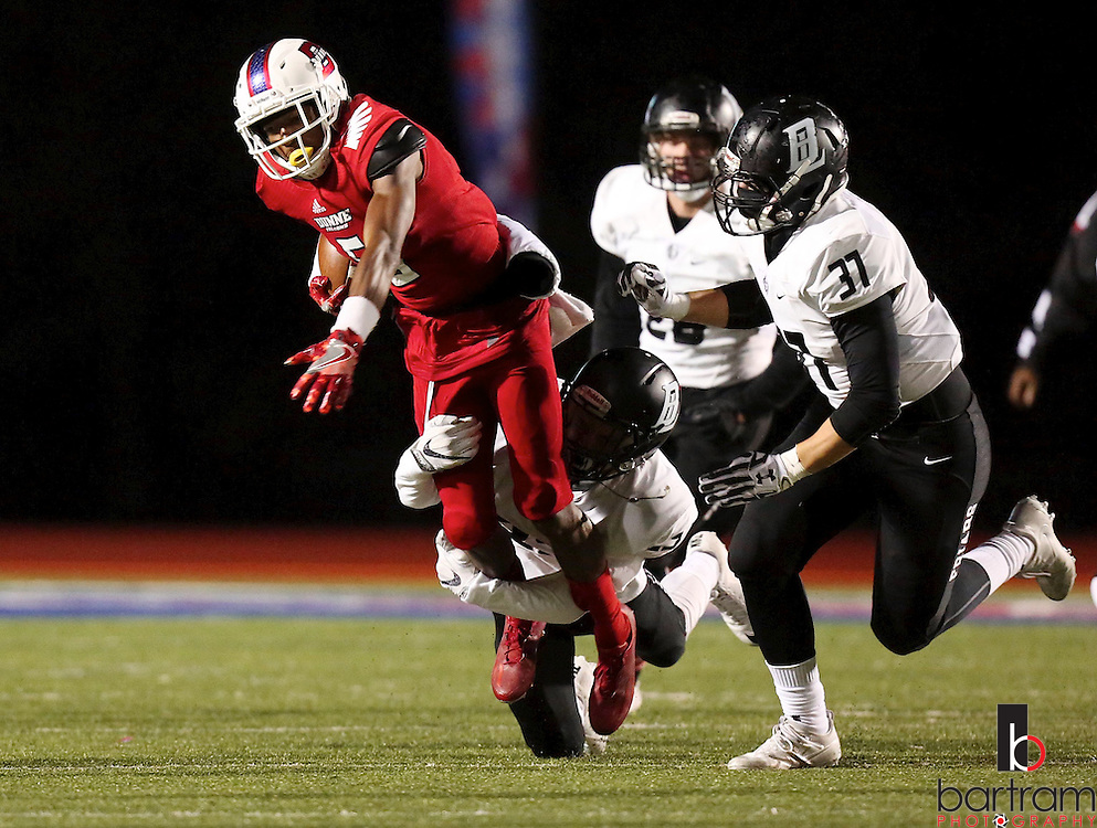 Bishop Dunne's Ricky Rollerson carries the ball during the TAPPS Division I state championship game on Saturday, Dec. 3, 2016 at Panther Stadium in Hewitt, Texas. Bishop Lynch High School won 21-17. (Photo by Kevin Bartram)