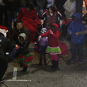 Children watch the 12th Annual Wilmington Holiday Parade Sunday December 7, 2014 in Wilmington, N.C. (Jason A. Frizzelle)