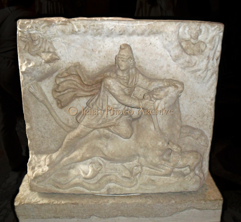 Stone relief depicting a man fighting a beast. Connected to the Mithraic mystery religion. A religion practised in the Roman Empire from 1st-4th century AD. It adopted the Persian God Mithra into the Greek Mithras, and was a very popular religion with the Roman military. Roman, Marble.