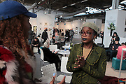 April 8, 2018-New York, New York-United States: Photographic Artist Adama Delphine Fawundu, Co-founder & Editor, MFON Journal attends the Photography Show presented by AIPAD held at Pier 94 on April 8, 2018 in New York City. The Photography Show, held at Pier 94, is the longest-running and foremost exhibition dedicated to the photographic medium, offering contemporary, modern, and 19th century photographs as wells photo-based art, video and new media.(Photo by Terrence Jennings/terrencejennings.com)