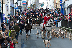 © Licensed to London News Pictures. 01/01/2019. Carmarthen, Carmarthenshire, Wales, UK. The Hunt arrive in the cente of town. Anti-Bloodsport activists gather in the Welsh town of Carmarthen to voice their anger at the continued illegal hunting with dogs - hunting with dogs was made illegal in 2004 by The Hunting Act 2004 (c37). The Anti-Hunt protest takes place on the day that the Carmarthenshire Hunt have chosen to parade through the town to collect money and support for their blood-sports. Photo credit: Graham M. Lawrence/LNP