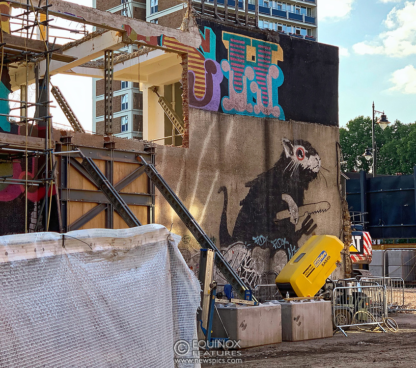 London, United Kingdom - 23 August 2019<br /> EXCLUSIVE SET - Aerial construction specialists and demolition experts use a huge crane to carefully lift intact, a twenty five ton, two-story wall, to preserve a famous Banksy rat image which has been covered up for years. Teams from specialist companies have spent over six weeks cutting around the artwork and fitting custom made eight ton steel supports to enable them to save the historic piece of art. Work has started on the construction of a new twenty seven floor art'otel hotel on the site of the old Foundry building in Shoreditch, east London, and a condition of the planning permission was to preserve the historical Banksy graffiti. A second section of the painting, an image of a TV being thrown through a broken window has already been cut out and moved separately. After the hotel construction is complete the two parts of the Banksy painting will be displayed on the hotel. Our pictures show the stages of work to protect the image, culminating in the lifting of the three story wall by crane. Video footage also available.<br /> (photo by: EQUINOXFEATURES.COM)<br /> Picture Data:<br /> Photographer: Equinox Features<br /> Copyright: ©2019 Equinox Licensing Ltd. +443700 780000<br /> Contact: Equinox Features<br /> Date Taken: 20190823<br /> Time Taken: 183932<br /> www.newspics.com