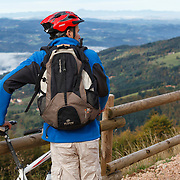 Mountain biker looking over the valley