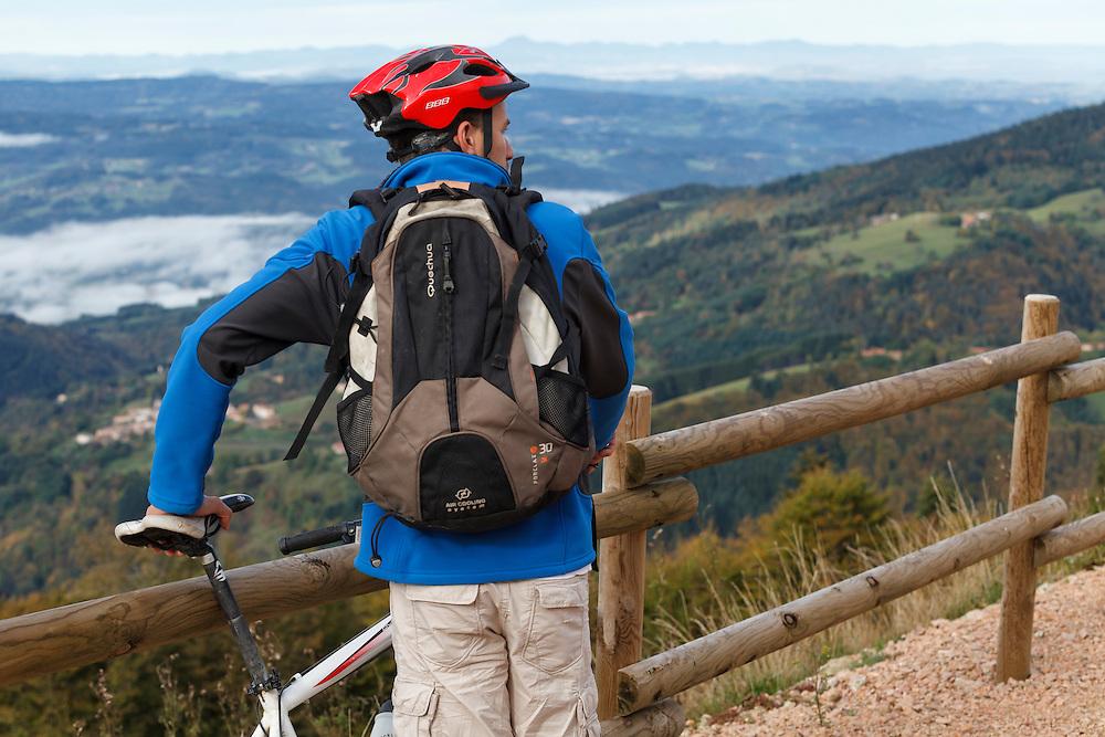 Mountain biker looking over the valley