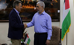September 5, 2017 - Gaza City, Gaza Strip, Palestinian Territory - The head of the International Committee of the Red Cross, Peter Maurer (L), shakes hands with leader of the Hamas Islamist movement in Gaza Yahya Sinwar following a meeting in Gaza City, on September 5, 2017  (Credit Image: © Mohammed Asad/APA Images via ZUMA Wire)