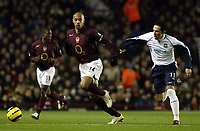 Photo: Chris Ratcliffe.<br />Arsenal v West Ham. Barclays Premiership. 01/02/2006.<br />Arsenal's Thierry Henry (L) gets away from Matthew Etherington.
