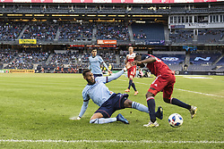 April 29, 2018 - Bronx, New York, United States - New York City defender SEBASTIEN IBEAGHA (33) knocks the ball; away from FC Dallas forward ROLAND LAMAH (20) during a regular season match at Yankee Stadium in Bronx, NY.  NYCFC defeats FC Dallas 3 to 1. (Credit Image: © Mark Smith via ZUMA Wire)