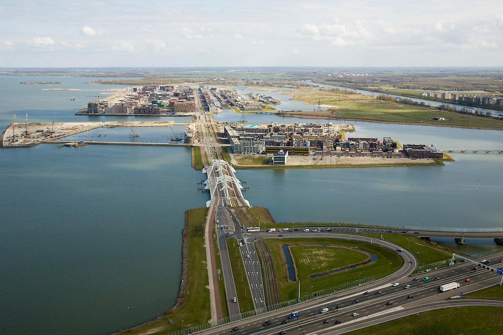 Nederland, Amsterdam, IJburg, 16-04-2008; Zeeburgereiland (met Ringweg A10) in de voorgrond, de Enneus Heermabrug (dubbele boogbrug) is de verbinding met IJburg; het eerste eiland is het Steigereiland daar achter Haveneiland (het rechterdeel bestaat uit het Grote en Kleine Rieteiland, geheel rechts Diemen-Zuid;.Zeeburgereiland (with Ring A10) in the foreground, the Enneus Heerma Bridge (double arch bridge) is the connection with IJburg, the first island is the Steigereiland Haveneiland behind (the right part consists of the Large and Small Island Reed, totally right Diemen-South.luchtfoto (toeslag); aerial photo (additional fee required); .foto Siebe Swart / photo Siebe Swart