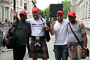 On the first day of the state visit by US President Donald Trump people come to see his arrival including these Trump supporters wearing Make America Great Again baseball caps on 3rd June 2019 in London, United Kingdom.