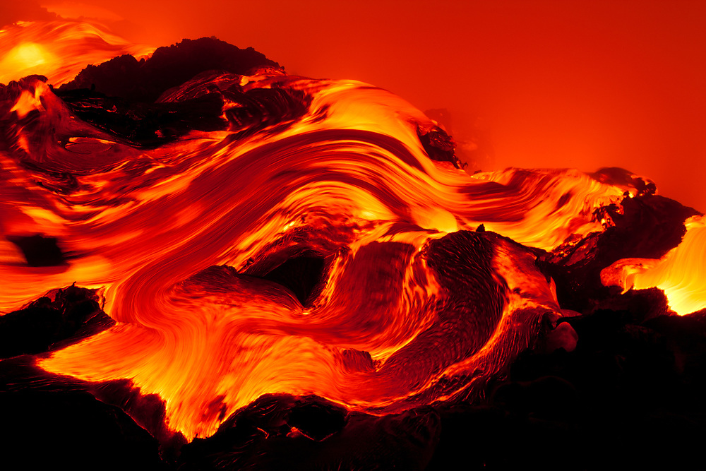 Chaos at the ocean entry. An intense scene as 2000 degree lava pours into the cool ocean.
