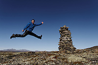 Man jumping in mountain landscape