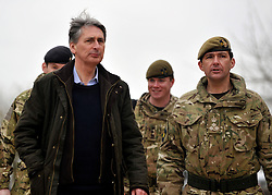 © Licensed to London News Pictures. 09/03/2012. Copedown Hill, UK. Secretary of Defence Philip Hammond talks to Brigadier Doug Chalmers as he visits troops who are being deployed to Afghanistan next month. The 12thMechanized Brigade (12 Mech Bde) at Copehill Down, Salisbury Plain Training Area, Wiltshire,on FRIDAY 09 MARCH 2012, as it prepares to deploy to Helmand Province, Afghanistan, on Operation Herrick 16, in the Spring of this year. The Brigade were performing a dynamic demonstration of combined Afghan/ISAF operations supported by surveillance assets and casualty evacuation capability. Tornado GR4 fast jest ground support was also displayed.. Photo credit : Stephen SImpson/LNP