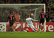 22.10.2013 Glasgow, Scotland.  Celtic's James Forrest scoring to make it 1-0 during the Champions League Game between Celtic and Ajax, from Parkhead Stadium.
