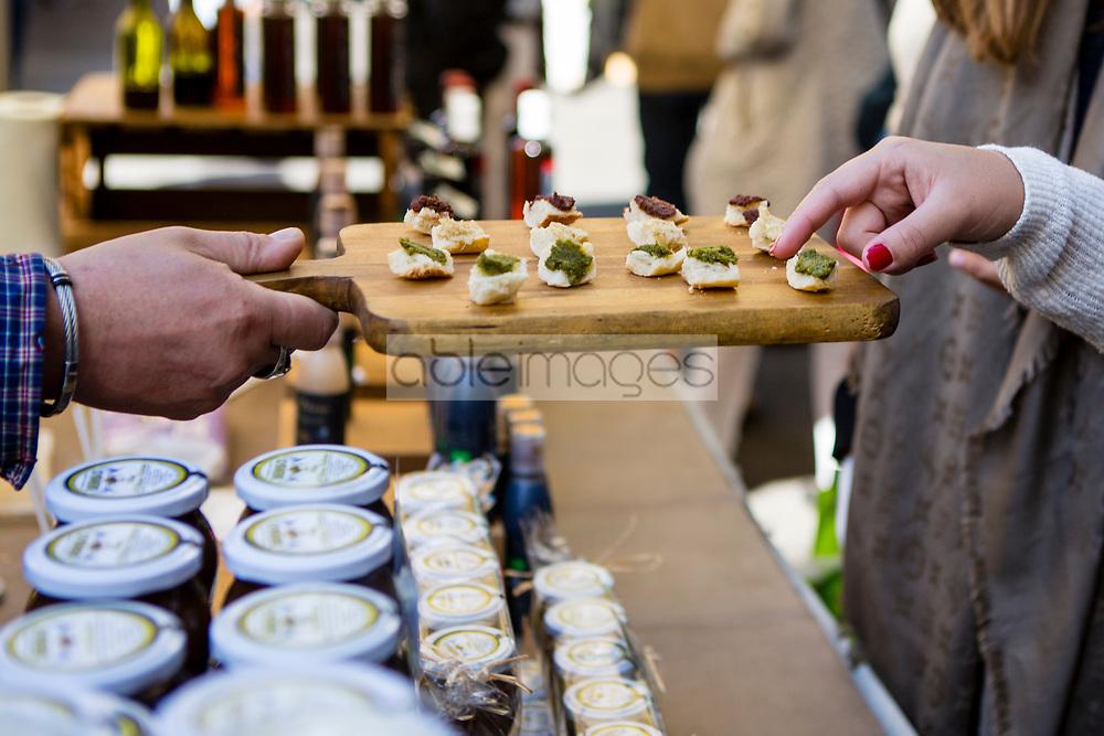 Fayence, Provence-Alpes-Côte d'Azur, France. Tasting Food at Outdoors Market