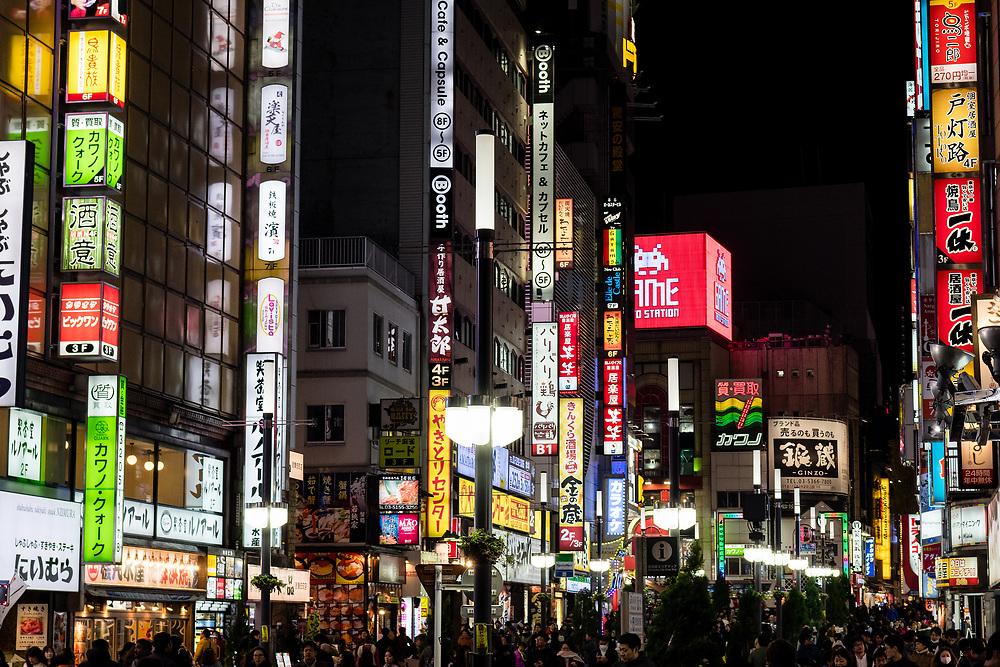 Towering neon signs of Shinjuku.