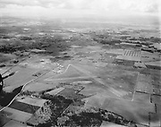 """Y-530407C-3. Aerials Hillsboro, Oregon airport. April 7, 1953. """"Oregonian aerial photo ... shows Hillsboro's 285-acre $545,000 airport with its two 4050-foot paved runways and city in background. Air force engineers considered field 'most likely' of sites examined for fighter-interceptor base if squadron were moved from Portland, yeilding to port's protests."""" Caption published in Oregonian April 8, 1953"""