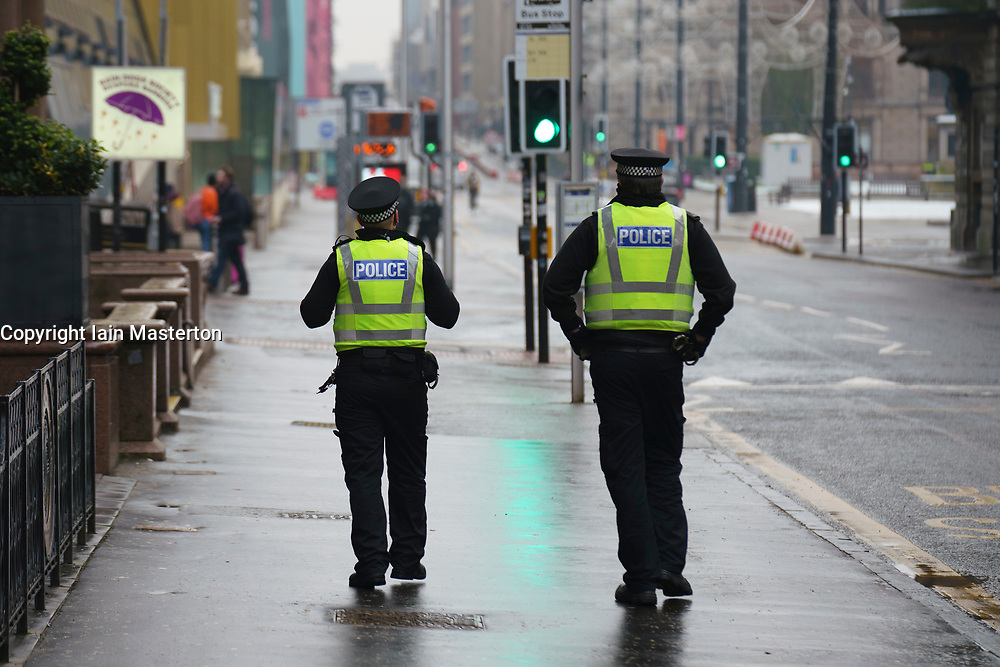 Glasgow, Scotland, UK. 7 January 2020. Scenes from morning in Glasgow city centre during the national Covid-19 lockdown. Normally busy streets are almost deserted because most shops and non essential businesses are closed. Pic; Police patrol the streets.    Iain Masterton/Alamy Live News