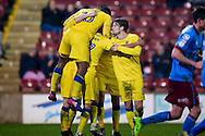 AFC Wimbledon celebrate AFC Wimbledon midfielder Dean Parrett (18) scoring a goal and celebrating to make the score  0-1 during the EFL Sky Bet League 1 match between Scunthorpe United and AFC Wimbledon at Glanford Park, Scunthorpe, England on 28 February 2017. Photo by Simon Davies.