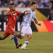 EAST RUTHERFORD, NEW JERSEY - JUNE 26:  Guido Pizarro #6 of Argentina is challenged by Arturo Vidal #8 of Chile during the Argentina Vs Chile Final match of the Copa America Centenario USA 2016 Tournament at MetLife Stadium on June 26, 2016 in East Rutherford, New Jersey. (Photo by Tim Clayton/Corbis via Getty Images)