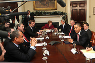 President Barack Obama talks into a speaker phone to CEO's in New York as he meets with members of the financial services industry on December 14, 2009. right to left:  President Obama, Secretary Geithner, Jim Rohr, PNC Jamies Dimon, JP Morgan, Christina Romer,  (not identified-not seen,) Robert Kelly, Bank of New York  Ronald Logue, State Street, Ken Chenault, AMEX . ) Photo by Dennis Brack