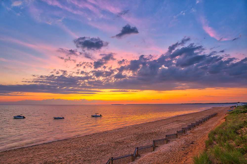 Scenic view of Cape Cod Bay and Thumpertown Beach at sunset. This beautiful Cape beach is located in Eastham, Massachusetts and only a few steps from one of Cape Cod's most iconic lighthouses Nauset Beach Light, famous for its logo appearance on the Cape Cod chips.<br /> <br /> Massachusetts Cape Cod Bay fine art photography images are available as museum quality photography prints, canvas prints, acrylic prints or metal prints. Fine art prints may be framed and matted to the individual liking and decorating needs:<br /> <br /> https://juergen-roth.pixels.com/featured/scenic-view-of-cape-cod-bay-thumpertown-beach-juergen-roth.html<br /> <br /> All New England photos are available for photography image licensing at www.RothGalleries.com. Please contact Juergen with any questions or request. <br /> <br /> Good light and happy photo making!<br /> <br /> My best,<br /> <br /> Juergen
