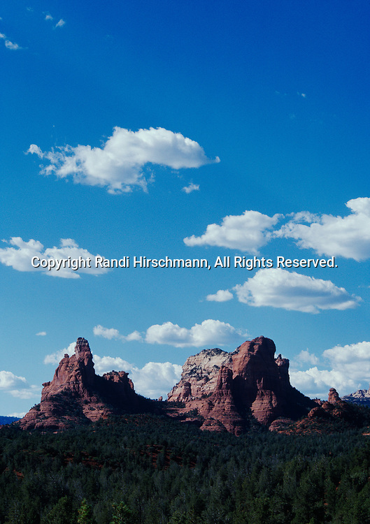 Cumulus clouds gathering over red rock buttes near Sedona, Coconino National Forest, Arizona.