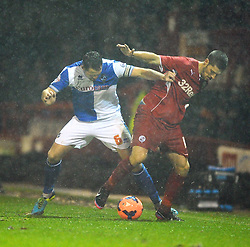 Bristol Rovers' Tom Parkes and Crawley Town's Jamie Proctor  battle for the ball - Photo mandatory by-line: Seb Daly/JMP - Tel: Mobile: 07966 386802 18/12/2013 - SPORT - FOOTBALL - Broadfield Stadium - Crawley - Crawley Town v Bristol Rovers - FA Cup - Replay