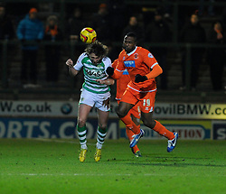 Blackpool's Ricardo Fuller collides with Yeovil Town's Luke Ayling  moments before lashing out, and being sent off - Photo mandatory by-line: Dougie Allward/JMP - Tel: Mobile: 07966 386802 03/12/2013 - SPORT - Football - Yeovil - Huish Park - Yeovil Town v Blackpool - Sky Bet Championship