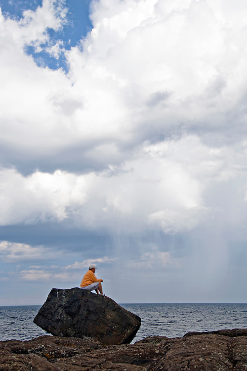 People explore the Black Rocks area of Presque Isle Park on Lake Superior in Marquette Michigan.