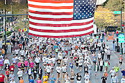 """This image of the Quad Cities Marathon 2009  illustrates that the race begins """"Under the Flag."""""""