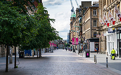 Glasgow, Scotland, UK. 6 June 2020. Normally busy shopping district of Buchanan Street in Glasgow city centre is almost deserted on a Saturday lunchtime. Shops and businesses remain closed and in many cases boarded up.  Iain Masterton/Alamy Live News