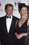 Catherine Zita-Jones and Michael Douglas. ICMEC Gala launch. Savoy. 5 October 2000.  © Copyright Photograph by Dafydd Jones 66 Stockwell Park Rd. London SW9 0DA Tel 020 7733 0108 www.dafjones.com