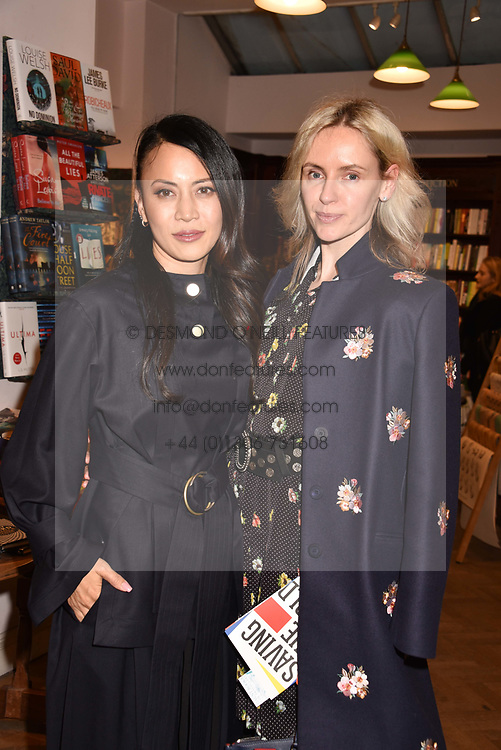 Left to right, Vicky Lee and Nadya Abela at a party to celebrate the publication of Saving The World by Paola Diana at Daunt Books, Marylebone, London England. 2 May 2018.