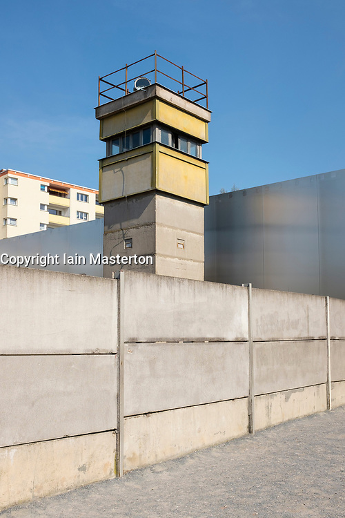 Reconstructed section of Berlin Wall with death strip and guard-tower at Berlin Wall Memorial on Bernauer Strasse , Berlin, Germany. The Gedenkstätte Berliner Mauer commemorates the division of Berlin by the Berlin Wall and the deaths that occurred there. The monument was created in 1998 by the Federal Republic of Germany and the Federal State of Berlin.