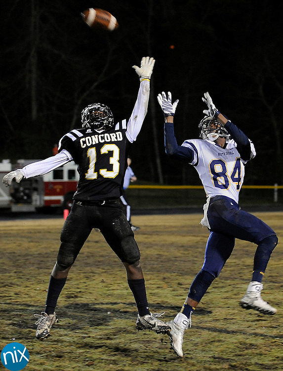 Spiders defensive back Davionne Eddie (13, left) breaks up this pass intended for Vikings wide receiver Jeremiah McMillan (84, right) during the 4th quarter of the South Iredell Vikings at Concord Spiders 3A high school football playoff game on Nov. 27.