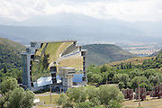 World's Largest Solar Furnace<br /> Font-Romeu-Odeillo-Via or simply Odeillo, is a commune in the Pyrenees mountains near the Spanish border in the south of France and is one of the sunniest places on earth. With over 3,500 hours of sunshine per year, it's no surprise that Odeillo is home to the world's largest solar furnace.<br /> <br /> Built in 1969 by the National Scientific Research Center, the solar furnace consist of a field of 63 heliostatic mirrors mounted on terraces on the surrounding hillside which bounce the sun's rays onto a large concave mirror. This focuses an enormous amount of sunlight onto an area roughly the size of a cooking pot, raising its temperature to 3,500 degrees Centigrade. The parabolic mirror itself is built out of 10,000 individual mirrors and covers an area of almost 2,000 square meters.<br /> <br /> The solar furnace is used by the National Scientific Research Center for studying heat transfer fluid systems, energy converters and the behavior of materials at high temperatures. These fields are of particular interest to the aerospace industry.<br /> ©Exclusivepix