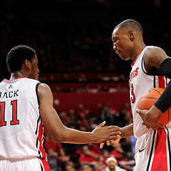 Kadeem Jack #11 and Wally Judge #33 of the Rutgers Scarlet Knights high five after Jack drew a foul call during the second half of Rutgers men's basketball vs Temple Owls in American Athletic Conference play on Jan. 1, 2014 at Rutgers Louis Brown Athletic Center in Piscataway, New Jersey.