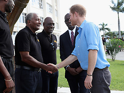 Prince Harry meets cricketer Andy Roberts as he attends a youth sports festival at the Sir Vivian Richards Stadium in North Sound, Antigua, on the second day of his tour of the Caribbean.