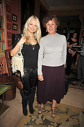 Left to right, HANNAH SANDLING and MARQUESA DE VARELA at a party to celebrate the publication of 'A Lion called Christian' held at 36 Chapel Street, London SW1 on 26th March 2009.