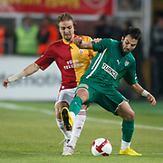 Galatasaray's Caner ERKIN (L) and Bursaspor's Volkan SEN (R) during their Turkish Super League soccer match Galatasaray between Bursaspor at the AliSamiYen Stadium at Mecidiyekoy in Istanbul Turkey on Sunday 25 April 2010. Photo by Aykut AKICI/TURKPIX