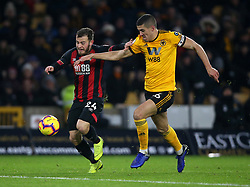 Wolverhampton Wanderers' Conor Coady (right) and Bournemouth's Ryan Fraser battle for the ball