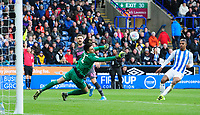 Huddersfield Town's Kamil Grabara denies Leeds United's Mateusz Klich, who had already been flagged offside<br /> <br /> Photographer Chris Vaughan - CameraSport<br /> <br /> The EFL Sky Bet Championship - Huddersfield Town v Leeds United - Saturday 7th December 2019 - John Smith's Stadium - Huddersfield<br /> <br /> World Copyright © 2019 CameraSport. All rights reserved. 43 Linden Ave. Countesthorpe. Leicester. England. LE8 5PG - Tel: +44 (0) 116 277 4147 - admin@camerasport.com - www.camerasport.com
