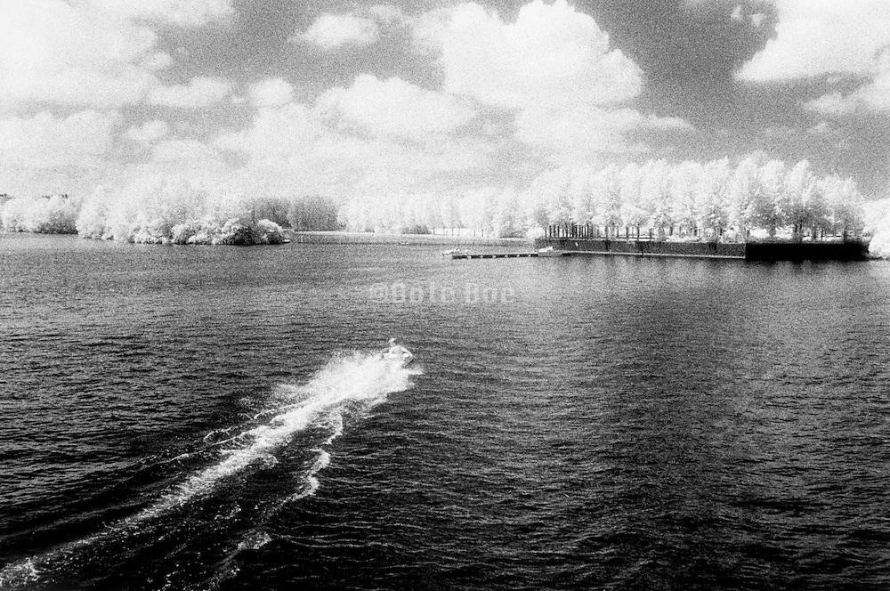 little motorboat speeding away Holland