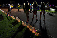 Goshen, New York - People walked laps around the track, which was lined with luminaria in remembrance of cancer victims, during the Relay for Life at Goshen High School on June 15, 2013. The Relay for Life is the American Cancer Society's signature fundraising event. Participants celebrate the lives of people who have battled cancer, remember loved ones lost, and fight back against the disease by raising money.