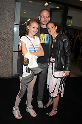 Artist DINOS CHAPMAN, his wife TIPHAINE and daughter AGAT at the opening of 'The House of Viktor & Rolf' an exhibtion of designs by Viktor & Rolf held at The Barbican Art Gallery, Silk Sytreet, London on 17th June 2008.<br /><br />NON EXCLUSIVE - WORLD RIGHTS