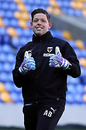 AFC Wimbledon goalkeeping coach Ashley Bayes giving thumbs up whilst warming up during the EFL Sky Bet League 1 match between AFC Wimbledon and Hull City at Plough Lane, London, United Kingdom on 27 February 2021.