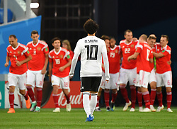 June 19, 2018 - Saint Petersburg, Russia - MOHAMED SALAH of Egypt reacts as players of Russia celebrate during a Group A match between Russia and Egypt at the 2018 FIFA World Cup in Saint Petersburg. Russia won 3-1. (Credit Image: © Li Ga/Xinhua via ZUMA Wire)